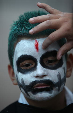 Joseph Gutierrez, 8, has his face painted  at the Springs Preserve for the Dia de los Muertos celebration in Las Vegas on Sunday, Nov. 2, 2014. (Justin Yurkanin/Las Vegas Review-Journal)