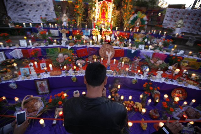 Aureliano Valdevinos looks at an altar at the Springs Preserve for the Dia de los Muertos celebration in Las Vegas on Sunday, Nov. 2, 2014. (Justin Yurkanin/Las Vegas Review-Journal)