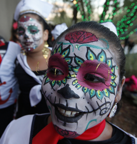 Adilene Corrales, 9, of Mexico Vivo dance group waits to perform on stage at the Springs Preserve for the Dia de los Muertos celebration in Las Vegas on Sunday, Nov. 2, 2014. (Justin Yurkanin/Las  ...