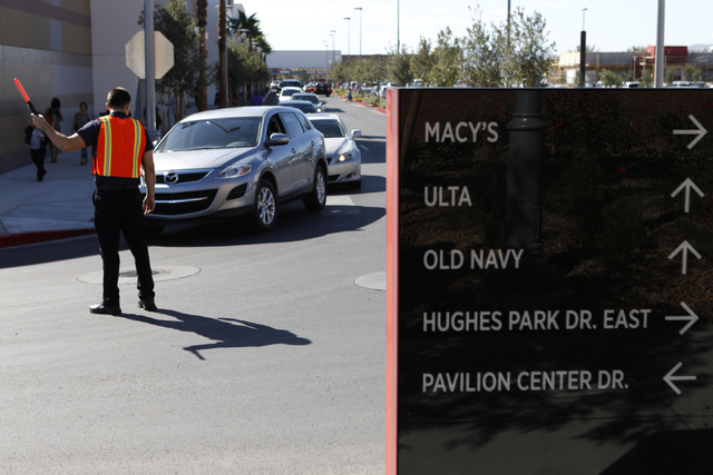 Valet employee German Rodriguez controls traffic at the Downtown Summerlin shopping center in Las Vegas during their grand opening Thursday, Oct. 9, 2014. (Erik Verduzco/Las Vegas Review-Journal)