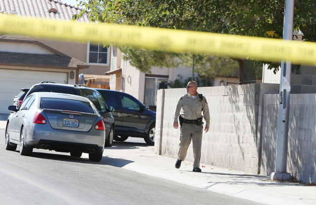 Las Vegas police investigate a fatal drive-by shooting in the 6900 block of Welsh Circle, near West Gowan Road and North Rainbow Boulevard, Thursday, Nov. 6, 2014. One man was found dead in the st ...