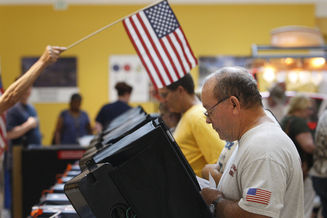 Paul Sonner casts his ballot during early voting at the Galleria Mall in Henderson Saturday, Oct. 18, 2014.  (Sam Morris/Las Vegas Review-Journal)