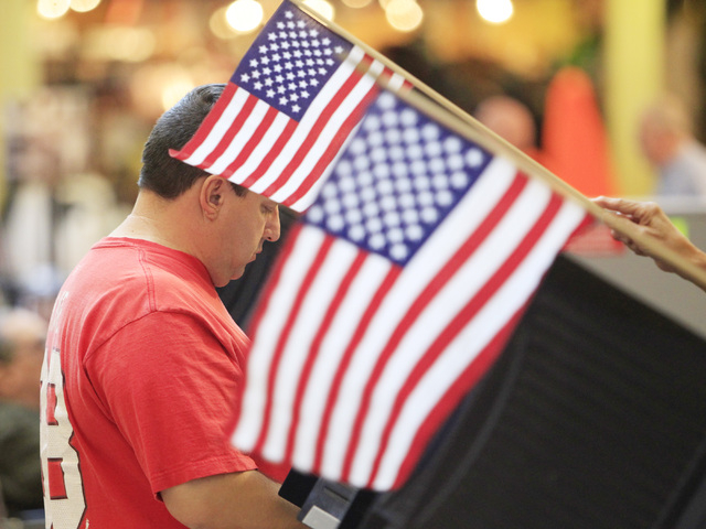 Javier Tamez casts his ballot during early voting at the Galleria Mall in Henderson Saturday, Oct. 18, 2014.  (Sam Morris/Las Vegas Review-Journal)