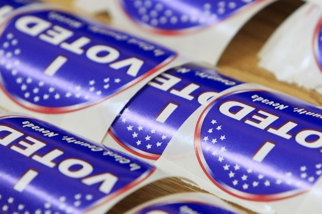 Stickers are seen during early voting at the Galleria Mall in Henderson Saturday, Oct. 18, 2014.  (Sam Morris/Las Vegas Review-Journal)