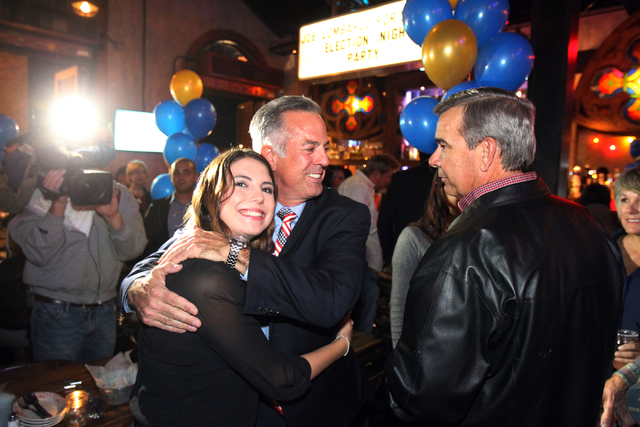 Las Vegas police Assistant Sheriff Joe Lombardo center hugs his daughter Morgan Lombardo while visiting with Sheriff Doug Gillespie, right, during an election night watch party at La Comida restau ...