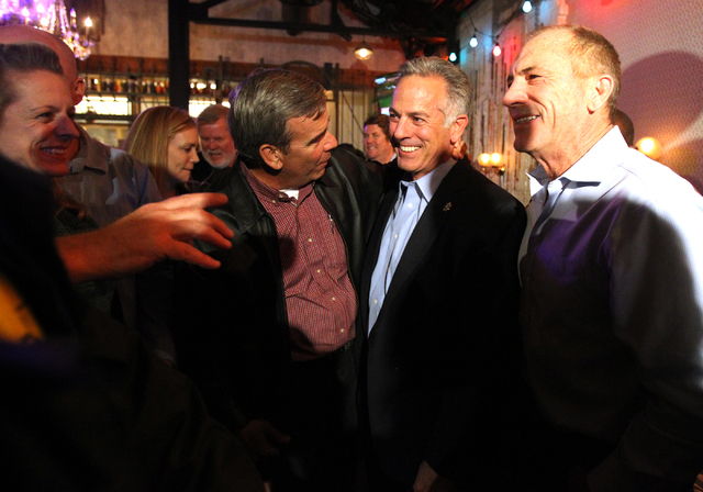 Las Vegas police Assistant Sheriff Joe Lombardo, center, celebrates with current Sheriff Doug Gillespie, left, and former Sheriff Bill Young after final results showed him winner of the Clark Coun ...