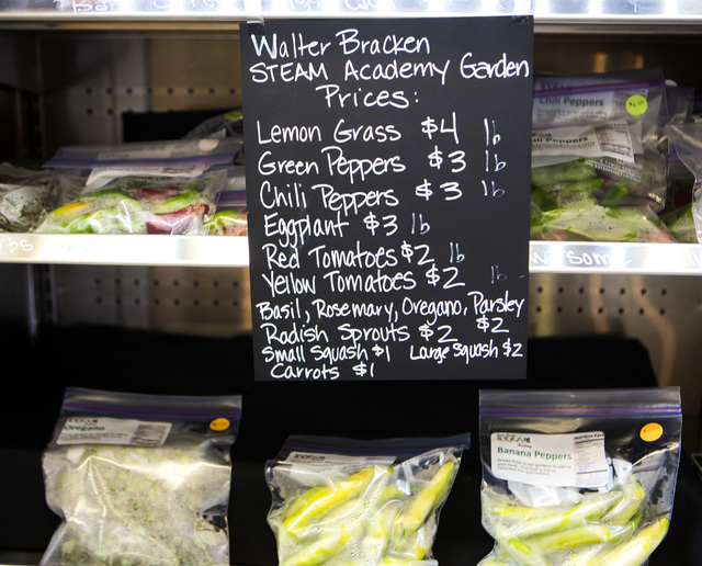 A selection of vegetables grown by students from Walter Bracken STEAM Academy Garden at The Market, 611 East Fremont, on Wednesday, Oct. 29,2014. The Downtown Project recently opened the grocery s ...