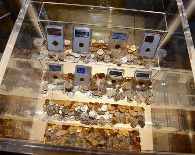 """Gold coins worth $500,000 set to be awarded to the first eligible reader who solves the interactive puzzle in the book """"Endgame: The Calling"""" are on display at Caesars Palace in Las Vegas. (Denise ..."""