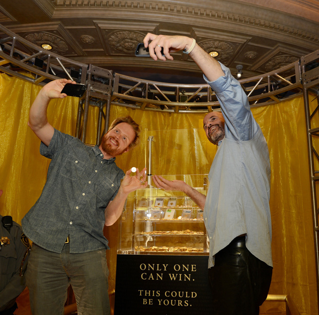 """Endgame: The Calling"" co-authors James Frey and Nils Johnson-Shelton pose for selfies at Caesars Palace with the $500,000 grand prize one reader could win using clues from their book. ( ..."