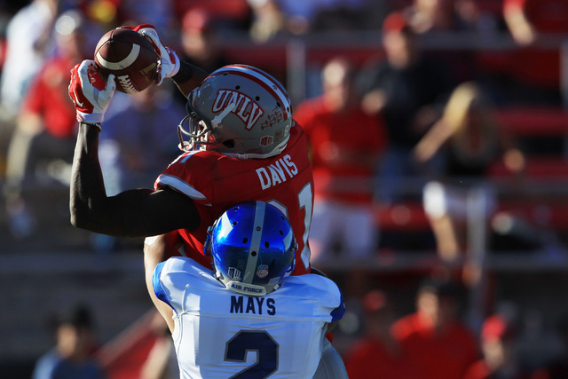 UNLV wide receiver Devante Davis (81) pulls in a pass while being covered by Air Force defensive back Jordan Mays during the first half of their Mountain West Conference game Saturday, Nov. 8, 201 ...
