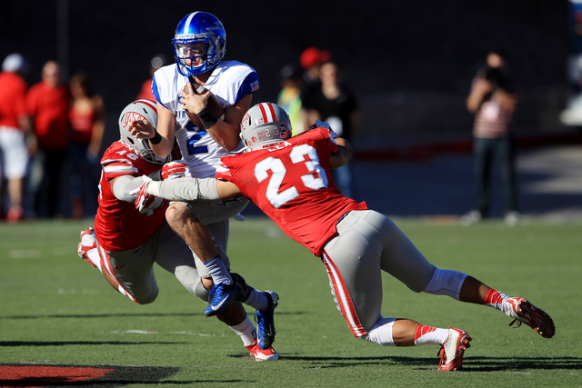 UNLV defensive lineman Siuea Vaesau (48) and defensive back Matt Lea (23) tackle Air Force quarterback Kale Pearson (2) during the first half of their Mountain West Conference game Saturday, Nov.  ...