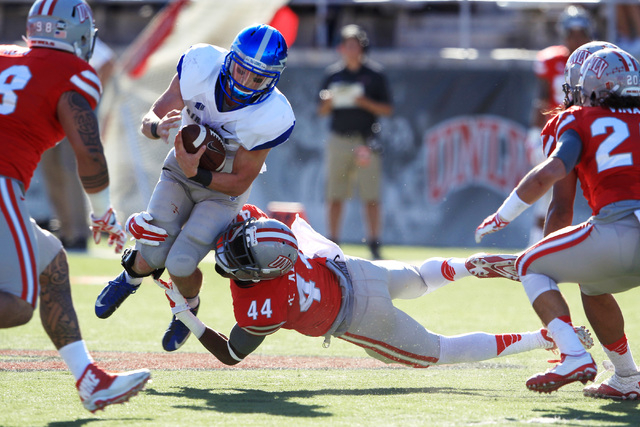 UNLV defensive back Kenny Keys (44) tackles Air Force quarterback Kale Pearson (2) during the first half of their Mountain West Conference game Saturday, Nov. 8, 2014 at Sam Boyd Stadium. (Sam Mor ...