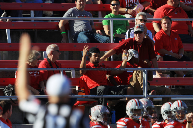 A UNLV fan raises his arms in bemusement after UNLV kicker shanked a punt into the stands during the first half of their Mountain West Conference game against Air Force Saturday, Nov. 8, 2014 at S ...