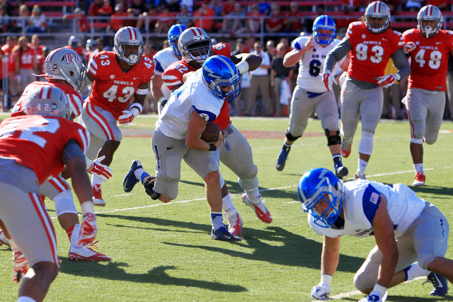 Air Force quarterback Kale Pearson (2) is chased by UNLV defensive lineman Brandon Willis (92) during the first half of their Mountain West Conference game Saturday, Nov. 8, 2014 at Sam Boyd Stadi ...