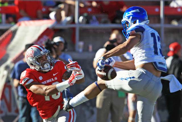 Air Force defensive back Justin DeCoud (13) breaks up a pass intended for UNLV wide receiver Maika Mataele (10) during the first half of their Mountain West Conference game Saturday, Nov. 8, 2014  ...