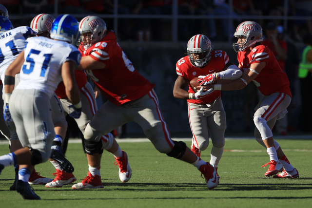 UNLV quarterback Blake Decker (5) hands off to UNLV running back Shaquille Murray-Lawrence (33) during the first half of their Mountain West Conference game against Air Force Saturday, Nov. 8, 201 ...