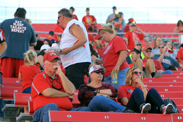 As the third quarter comes to a close, some UNLV fans begin to leave while others remain in their seats during UNLV's game against Air Force Saturday, Nov. 8, 2014 at Sam Boyd Stadium. Air Force w ...