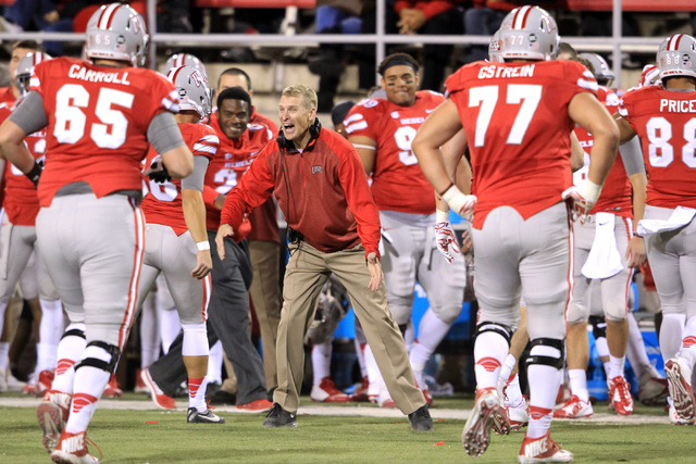 In his final game at the helm, UNLV head coach Bobby Hauck cheers his team after a field goal against Nevada during their game Saturday, Nov. 29, 2014 at Sam Boyd Stadium. (Sam Morris/Las Vegas Re ...