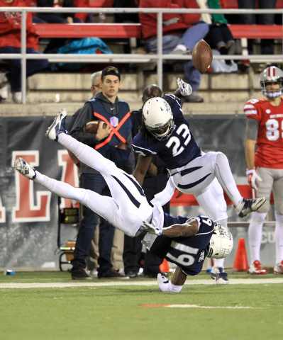 Nevada defensive backs Evan Favors (19) and Nigel Haikins (23) collide while breaking up a UNLV pass play during their game Saturday, Nov. 29, 2014 at Sam Boyd Stadium. (Sam Morris/Las Vegas Revie ...
