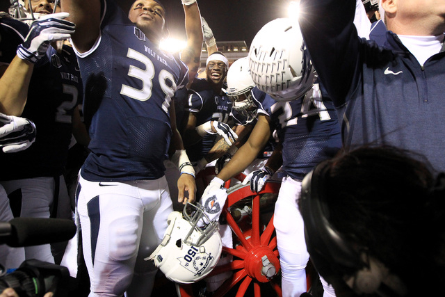 Nevada players celebrate with the Fremont Cannon after their game against UNLV Saturday, Nov. 29, 2014 at Sam Boyd Stadium. Nevada won 49-27. (Sam Morris/Las Vegas Review-Journal)