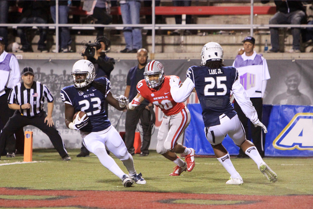 Nevada defensive back Nigel Haikins intercepts a pass intended for UNLV wide receiver Maika Mataele during their game Saturday, Nov. 29, 2014 at Sam Boyd Stadium. Nevada won 49-27. (Sam Morris/Las ...