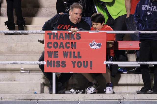 Tim Bowling and his son Turner Bowling show their support for head coach Bobby Hauck during their game against Nevada Saturday, Nov. 29, 2014 at Sam Boyd Stadium. Nevada won 49-27. (Sam Morris/Las ...