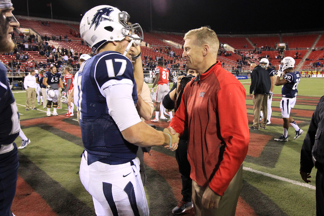 UNLV head coach Bobby Hauck congratulates Nevada quarterback Cody Fajardo after their game Saturday, Nov. 29, 2014 at Sam Boyd Stadium. Nevada won 49-27. (Sam Morris/Las Vegas Review-Journal)