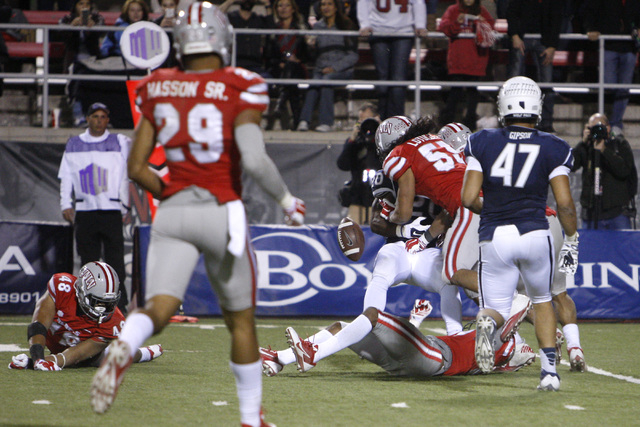 UNLV linebacker Tau Lotulelei causes Nevada running back James Butler to fumble during their game Saturday, Nov. 29, 2014 at Sam Boyd Stadium. Nevada wide receiver Jerico Richardson picked up the  ...