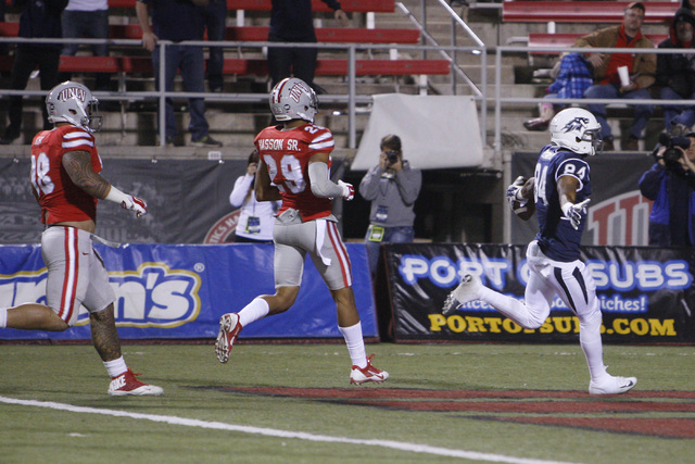 Nevada wide receiver Jerico Richardson hits the end zone after picking up a teammate's fumble during their game against UNLV Saturday, Nov. 29, 2014 at Sam Boyd Stadium. Nevada won 49-27. (Sam Mor ...