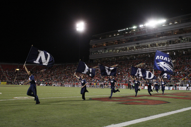 Nevada cheerleaders celebrate a touchdown against UNLV during their game Saturday, Nov. 29, 2014 at Sam Boyd Stadium. (Sam Morris/Las Vegas Review-Journal)