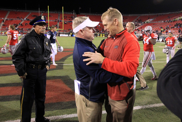 Nevada head coach Brian Polian and UNLV head coach Bobby Hauck embrace after their game Saturday, Nov. 29, 2014 at Sam Boyd Stadium. Nevada won 49-27. (Sam Morris/Las Vegas Review-Journal)