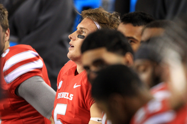 UNLV quarterback Blake Decker sits on the bench after another three-and-out during their game against Nevada Saturday, Nov. 29, 2014 at Sam Boyd Stadium. Nevada won 49-27. (Sam Morris/Las Vegas Re ...