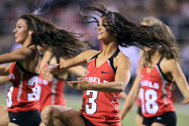 The UNLV dance team performs during their game against Nevada Saturday, Nov. 29, 2014 at Sam Boyd Stadium. Nevada won 49-27. (Sam Morris/Las Vegas Review-Journal)