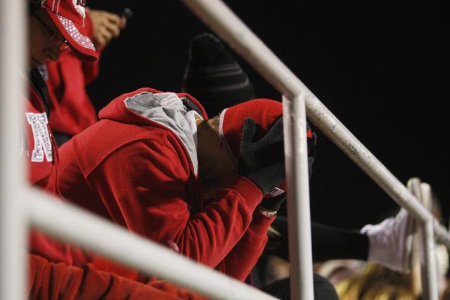 UNLV fan Alex Seda buries his head in his hands during their game against Nevada Saturday, Nov. 29, 2014 at Sam Boyd Stadium. Nevada won 49-27. (Sam Morris/Las Vegas Review-Journal)