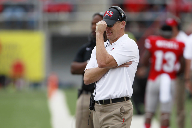 UNLV head coach Bobby Hauck tugs on his hat after the Rebels gave up a touchdown to New Mexico during their Mountain West Conference game Saturday, Nov. 1, 2014 at Sam Boyd Stadium. (Sam Morris/La ...