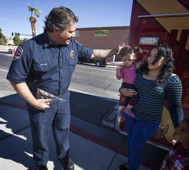Las Vegas  firefighter Ben Kole greets Yadira Gonzales and her daughter, Alexa, 14 months, at Las Vegas Fire Station No. 108, 4555 E. Bonanza Road, on Wednesday, Nov. 5, 2014. Kole was named AAA R ...