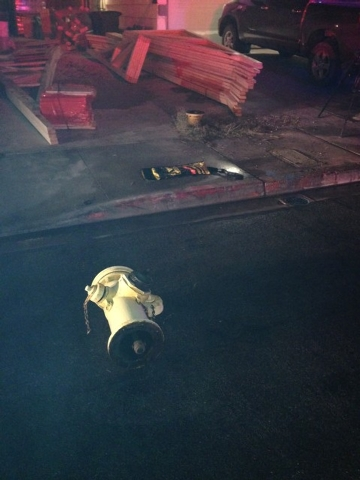A fire hydrant flew into the air during a fire in an abandoned house in the 1000 block of Sproul Court, near West Charleston and Rainbow boulevards, early Thursday morning, Nov. 27, 2014, the Las  ...