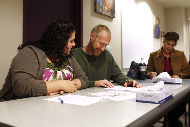 Amanda and Nathaniel Corbell fill out paperwork to begin the process of becoming foster parents during an informational meeting Tuesday, Nov. 18, 2014, at Child Haven. (Sam Morris/Las Vegas Review ...
