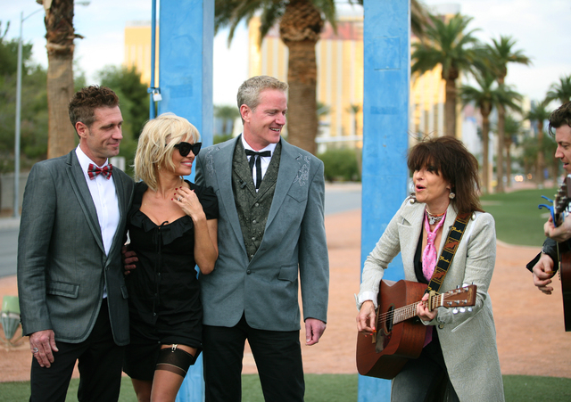 Jack Ryan, from left, actress Pamela Anderson, and Dan Mathews, senior vice president of PETA, are serenaded by rock icon Chrissie Hynde and James Walbourne after the wedding ceremony of Ryan and  ...