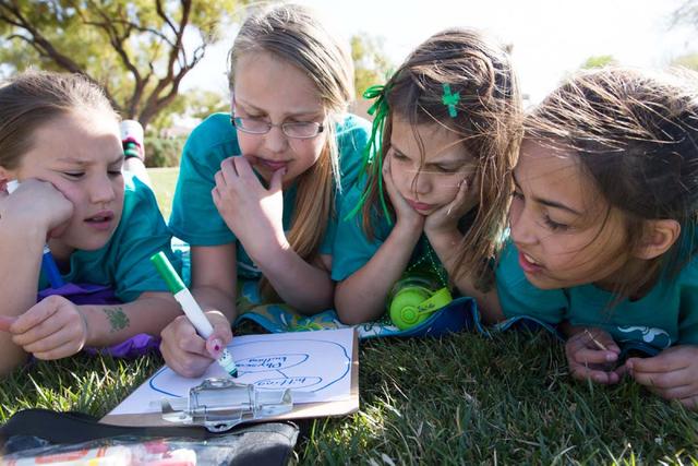 From left, Girls on the Run members Afton Feller, Emma Marrufo, Jane Castillo and Daytona DeLeon work on an exercise meant to identify bullying behavior at Staton Elementary School, 1700 Sageberry ...