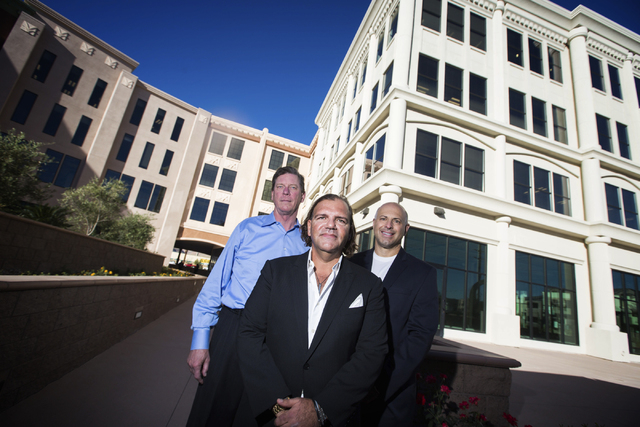 Developers Davi Pyle,left, with Krauz Companies, Ofir Hagay, WGH Partners, and Jay Krigsman, Krauz Companies, stands in the courtyard at Gramercy, 9257 W. Russell on Thursday, Nov.6,2014. Tenants  ...