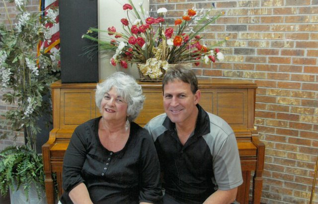 """Theresa Holder and her son Jesse """"Jake"""" Holder share a moment on Mother's Day 2010 at a Las Vegas senior center. Her husband died when Jake was 16, and ever since, he's been there to help  ..."""