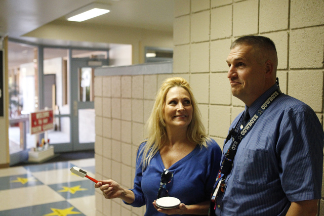 Treem Elementary School principal Lee Esplin, right, reacts to a mural art teacher Lori McArdle is painting on a wall inside Treem Elementary School in Henderson Wednesday, Nov. 5, 2014. Esplin wa ...
