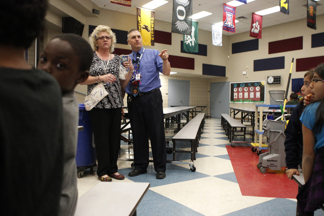 Lee Esplin, right, principal of Treem Elementary School, speaks with instructional assistant Diane Nesci inside the cafeteria at Treem Elementary School in Henderson Wednesday, Nov. 5, 2014. Espli ...