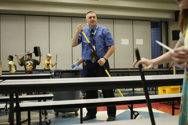 Lee Esplin, principal of Treem Elementary School, mops the cafeteria floor during lunchtime at Treem Elementary School in Henderson Wednesday, Nov. 5, 2014. Esplin was recently named Nevada Princi ...