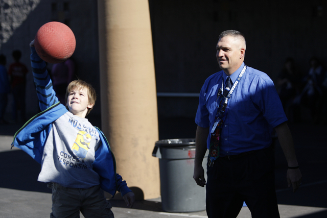 Lee Esplin, right, principal of Treem Elementary School, plays wall ball with fifth-grade student Daniel Brewer during lunchtime at Treem Elementary School in Henderson Wednesday, Nov. 5, 2014. Es ...