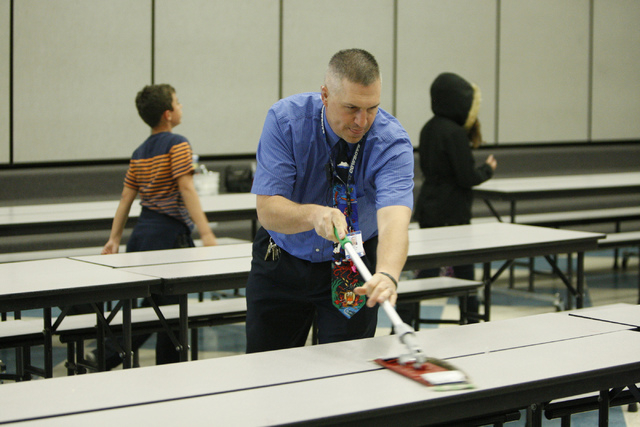 Lee Esplin, principal of Treem Elementary School, cleans a table inside the cafeteria during lunch time at Treem Elementary School in Henderson Wednesday, Nov. 5, 2014.  Esplin was recently named  ...