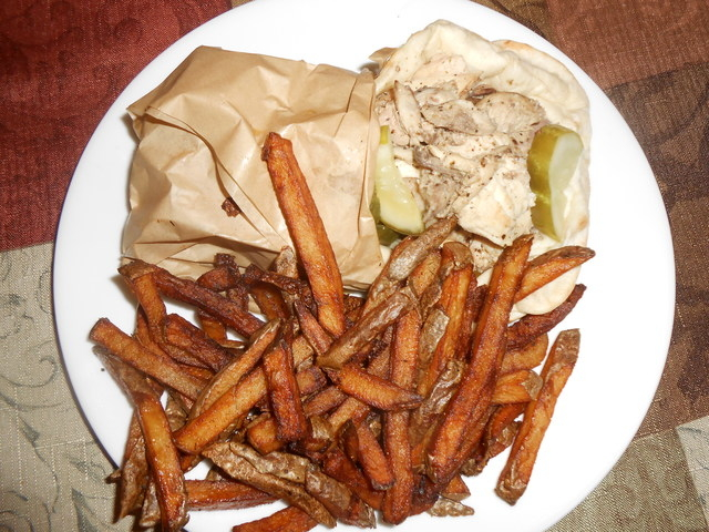 Chicken sandwich with fried potatoes is shown at Hedary's Mediterranean Restaurant. (Jan Hogan/View)