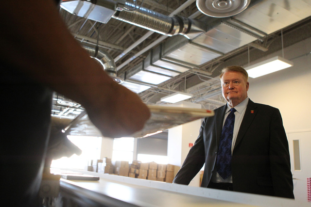 Dr. Ronald Heezen, new executive director for the Las Vegas-Clark County Library District, gives a tour of the central sorting system inside the Windmill Library in Las Vegas Thursday, Nov. 20, 20 ...