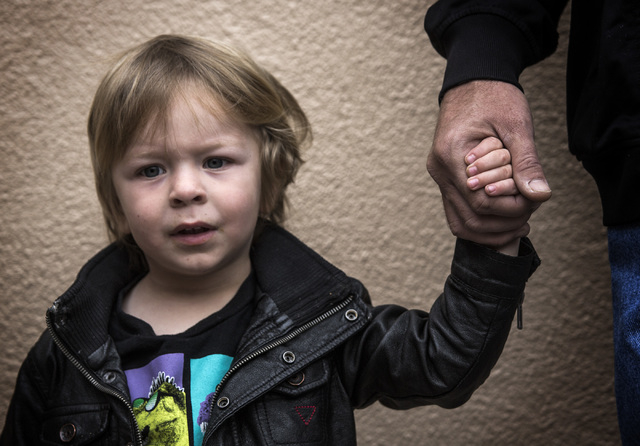 Joe Anderson,right, holds the hand of his 2-year-old son Darythe  during the annual Project Homeless Connect at Cashman Center, 850 Las Vegas Boulevard North, on Wednesday, November 19,2014. Thous ...